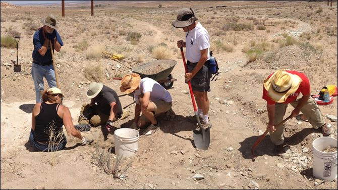 Dino Tracks Utah Volunteers work with the Utah Friends of Paleontology, the Bureau of Land Management, and the University of Colorado at Denver uncovering the track site north of Moab, Utah in June, 2013.