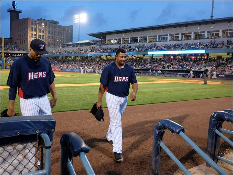 Toledo Mud Hens relief pitcher Melvin Mercedes walks to the dugout after giving up three runs against the Louisville Bats.