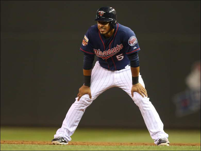 Minnesota Twins' Eduardo Escobar leads off first base.