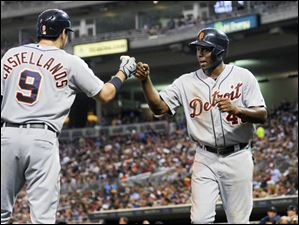 Detroit Tigers Torii Hunter, right, celebrates with Nick Castellanos (9) after scoring on a J.D. Martinez single.