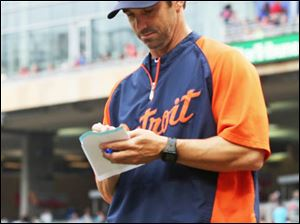 Detroit Tigers manager Brad Ausmus returns to the dugout after a lineup change in the ninth inning of Game 1.