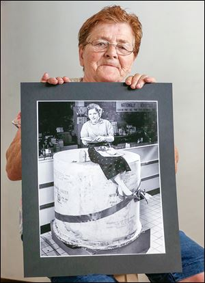 Evelyn Sandrock, 79, holds the now famous Blade photo of her at Tiedke's Department Store in 1955. She worked in the store's advertising office.