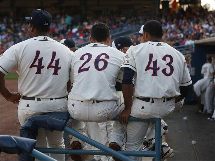 The Mud Hens' Melvin Mercedes (44), Hernan Perez (26) and Jose Ortega (43) watch their teammates bat.