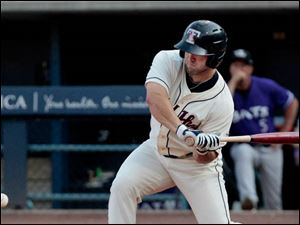 Mud Hens' Tyler Collins takes a swing in the bottom of the third inning.