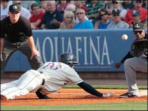 Mud Hens' Hernan Perez beats the Bats' Ruben Gotay back to first.