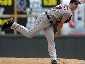 Detroit Tigers' Max Scherzer pitches against the Minnesota Twins.