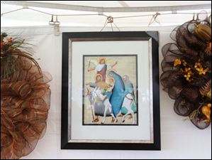 A painting of the Holy family done on papyrus hangs for sale.