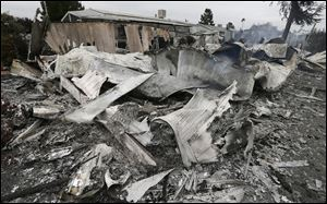 The remains of a mobile home are seen after a gas fire destroyed it as the result of a magnitude 6.0 earthquake Sunday, Aug. 24, 2014, at the Napa Valley Mobile Home Park, in Napa, Calif. A large earthquake caused significant damage and left at least three critically injured in California's northern Bay Area early Sunday.