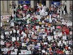 In 2012, protesters rallied at the Capitol in Lansing, protesting right-to-work legislation. Teachers' decisions this month will be the law's first big test.