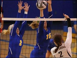 St. Ursula's Stephanie Sylvester, left, and Elizabeth Coil attempt to block a shot by Perryburg's Savannah Miller.
