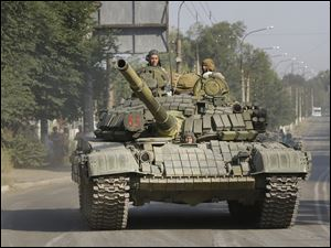 One of tanks in a convoy, heading from direction of Russia into town of Krasnodon in eastern Ukraine.