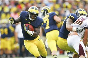 Michigan's De'Veon Smith will be counted on at running back. He gaine 117 yards in 26 carries in 2013.