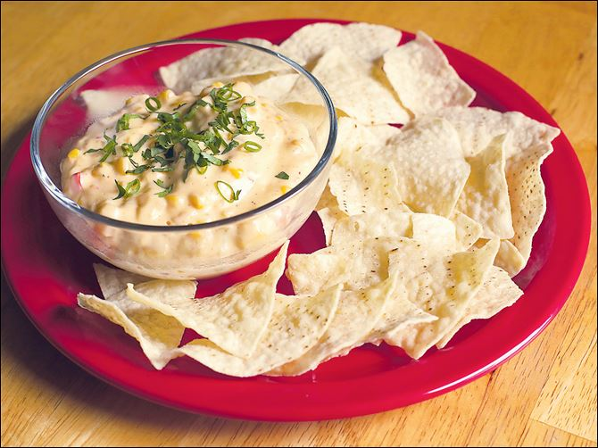 Hatch pepper cheddar corn dip with tortilla chips.