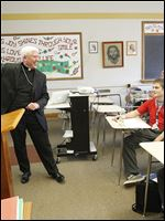 Bishop Daniel E. Thomas visits students at Central Catholic High School near downtown Toledo after the announcement of his new position in Toledo.