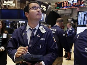 Trader Leon Montana works on the floor of the New York Stock Exchange. U.S. stocks opened slightly higher on Tuesday and remained in positive territory as economic reports touted a rise in consumer confidence, an increase in durable goods orders, and a rise, though slower, in U.S. home prices.
