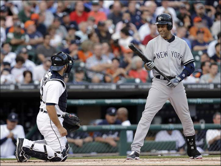 New York Yankees, Derek Jeter, right, laughs with Detroit Tigers catcher Alex Avila while batting.