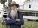 Sam Mullet stands in front of his Bergholz, Ohio, home. An appeals court on Wednesday, Aug. 27, 2014  overturned the hate-crime convictions of 16 Amish in beard- and hair-cutting attacks on fellow members of their faith in Ohio.