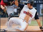 Mud Hens third baseman Wade Gaynor scores against  Columbus catcher Luke Carlin in the fifth inning.