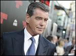 Pierce Brosnan attends the premiere of '‍The November Man' at TCL Chinese Theatre in Los Angeles.