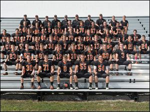 Liberty Center High School football team 2014   ROW 1:PAUL CLAWSON, JOSH CARPENTER, JORDAN SMITH, VINCE POSPISIL, DYLAN CLENDENINROW 2:KODY KREGULKA, NICK STEVENS, CHASE HILL, DYLAN SEXTON, BROOKS HINTON, ALEC MYERS, NATHAN WALKER, LOGAN SMITHROW 3:AUSTIN BACHMAN, CHRISTIAN DAWE, CODY SPRADLIN, ZACK CARPENTER, BRAXTON TEJKL, RYAN DEMALINE, CHRISTIAN CHAMBERS, ZANE PETERSON, LOGEN MCCULLOUGH, MATTHEW PIPPINROW 4:STEPHEN ARNETTE, ELIJAH RISING, KODY WOODS, BRYCEN ESPINOZA, CODY BUOTE, SPENCER HULL, ETHAN CRAMER, SHAWN JUDGE, JARED STURGELL, BLAISE MILLERROW 5:ANDRUE OSBORNE, KEATON OEHLER, NORTH WEST, MATEO ESPINOZA, LUCAS FRANKFORTHER, SAM SANCHEZ, DEVIN GOOD, JACOB EMBREE, CHRISTIAN KAHLEROW 6:NICK MILLER, CASEY MOHLER, DAN CLENDENIN, CHRIS RIGHI, CARL CARTER, REX LINGRUEN – HEAD COACH, MATT BRYAN, DAN CONRAD, KATIE JOHNSTON – ATHLETIC TRAINER, HEATHER DEVELVIS – STUDENT ATHLETIC TRAINER Handout NOT BLADE PHOTO
