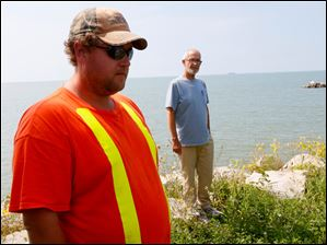 Kyle Davis, Environmental Services Manager, left, and Wayne Miller, Chief Administrative Officer with the Municipality of Pelee Island, right, stand outside of the West Shore Treatment Plant.