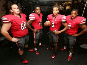 Central Catholic football players from left to right  Christian Ward, Jermiah Braswell, Marcus Winters and Stephon Campbell.