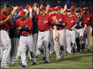 The Columbus Clippers celebrate defeating the Toledo Mud Hens.