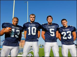 Lake High School football players from left, Branden Short (43), Todd Walters (10), Jared Rettig (5), and Adam Duncan (23).