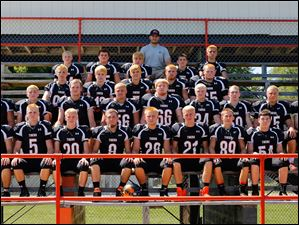 2014 North Baltimore High School football team.  FROM LEFT Row 1: T.J. Harshamn, Lane Bishop, Christian Richmond, Jacop Dick, Levi Newcomer, Jacob Pelton, Bryce Lennard, Joe White. Row 2: Rikko Phamakao, Alex Nichols, Sean Watson, Zach Meggitt, Kaleb Andrus, Andrew Hollinger, William Griffith IV, Body Naugle, Hank Matthes. Row 3: Matt Andrus, Jimmy Smith, Noah Brian, Taylor Bishop, Bryce Gunter Row 4: Chase Naugle, Owen Stewart, Chase Cotterman, David Patterson, Noah Cotterman Row 5: head coach Greg Bishop