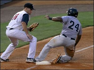 Toledo 3rd baseman Wade Gaynor is late to tag Columbus' Carlos Moncrief.