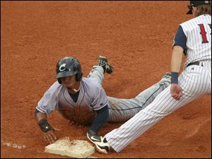 Columbus' Francisco Lindor is picked off at first base by 1st baseman Jordan Lennerton.