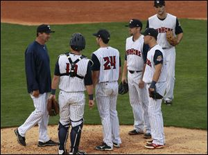Toledo pitching coach Al Nipper approaches starting pitcher Robbie Ray (24) during a game against Columbus.