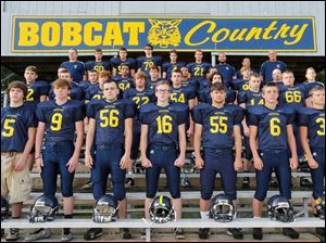 The 2014 Whiteford High School football team in Ottawa Lake, Michigan  FROM LEFT Row 1: Preston Schrier, Christian Carpenter, Blake Wing, Micah Cossins, Jessie Kiefer, Jacob Shelton. Row 2: Andrew Mercurio, Cody Kiefer, Jake Becki, Josh Beck, Garrett Hetzel, Hunter Nagle, Austin Cairl, Kris Wingerd. Row 3: Assistant coach Kris Hoag, Kevin Kaufman, Joe Link, Aaron Inman, Phoenix Mullins, head coach Jason Mensing, trainer Kelsey Shearman. Row 4: Assistant coach Bob Ondrovick, Tyler Wilson, Steven Bieber, Mitchell Iott, Nathan Wingate, Jay Gilmore, Jim Nagle, Tom Eitniear.