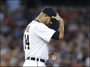 Detroit Tigers pitcher David Price reacts in the third inning against the New York Yankees. Price allowed eight earned runs in two innings.