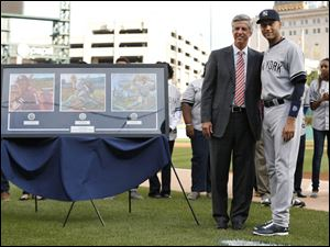Detroit Tigers general manager Dave Dombrowski stands with New York Yankees shortstop Derek Jeter in a special on-field ceremony.