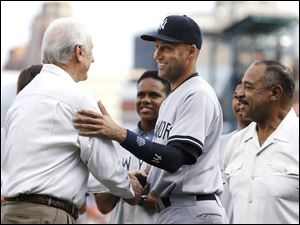 Detroit Tigers Hall-of-Famer Al Kaline, left, greets New York Yankees shortstop Derek Jeter, center, as Willie Horton looks on in a special on-field ceremony.