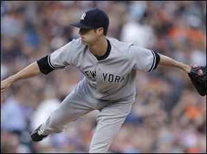 New York Yankees pitcher Shane Greene throws against the Detroit Tigers.