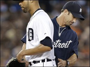 Detroit Tigers pitcher David Price, left, is taken out of the game by manager Brad Ausmus in the third inning.