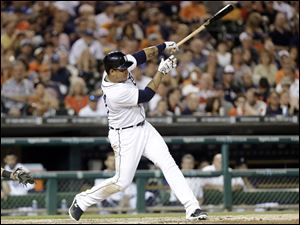 Detroit Tigers' Miguel Cabrera hits an RBI double against the New York Yankees.