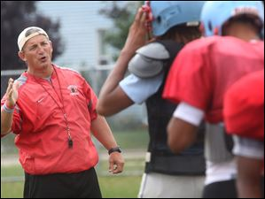 Bowsher coach Craig Lubinski conducts practice at Bowsher High School in South Toledo. The Rebels are gearing up for the season.