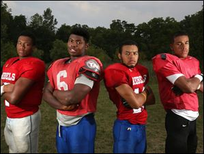Junior Chris Sudduth, left, and seniors Justus Satterfield, center left, Doniven Clark, center right, and Vince Hill, right, are all returning to Bowsher's lineup this fall.