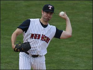 Starting Toledo pitcher Robbie Ray makes a throw to first base to prevent Columbus from leading off too far.