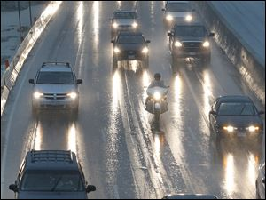 Despite horrific weather at times, Toledo commuters — here on I-475 West — have lower costs than in most cities, a report says.