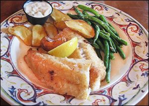 Fried walleye, served with fingerling potatoes & vegetable