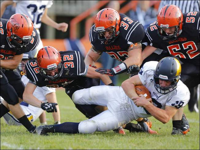 Summerfield players Cole Bischoff (36) John Heisler (32) Broc Roberts (33) and Oak Arquette (52) tackle Erie Mason player Austin Penn (19) during the first quarter.