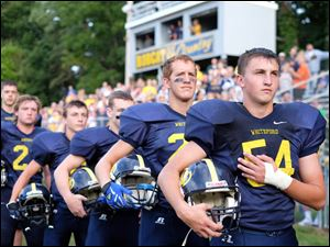 Whiteford football players including Garrett Hetzel (54) stand during the National Anthem before playing  Blissfield.