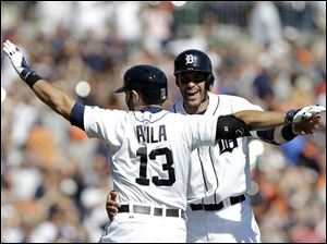 Detroit Tigers' Alex Avila (13) celebrates with J.D. Martinez after hitting a walk off single to score Bryan Holladay.