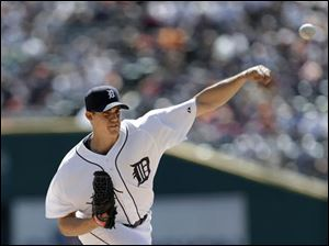 Detroit Tigers pitcher Kyle Lobstein throws against the New York Yankees.