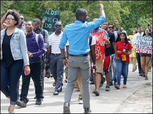 Robert Delk, president of the University of Toledo's Black Student Union, leads a march on the University of Toledo campus commemorating the 51st anniversary  of the March on Washington.