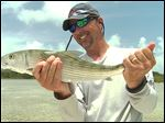 Ohio State football coach Urban Meyer with a bonefish he caught July 2013 while fishing in the flats of the Abacos Islands in the Bahamas.